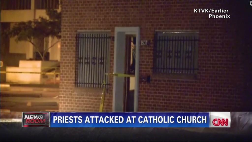 140612104111-sot-parishioners-mourn-slain-priest-church-shooting-00004327-tablet-large
