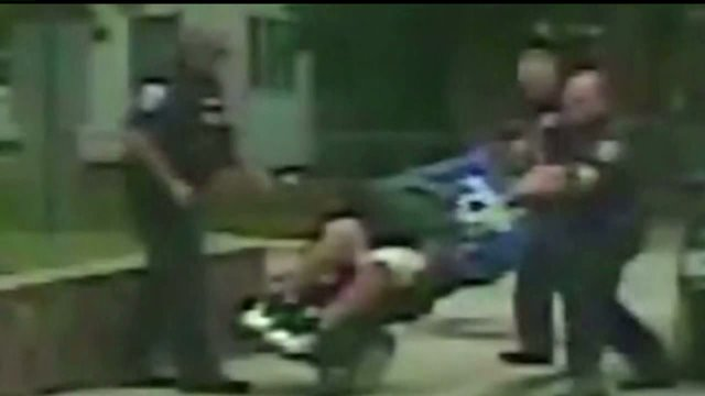 Shocking video of Lafayette police officer pushing over man in wheelchair