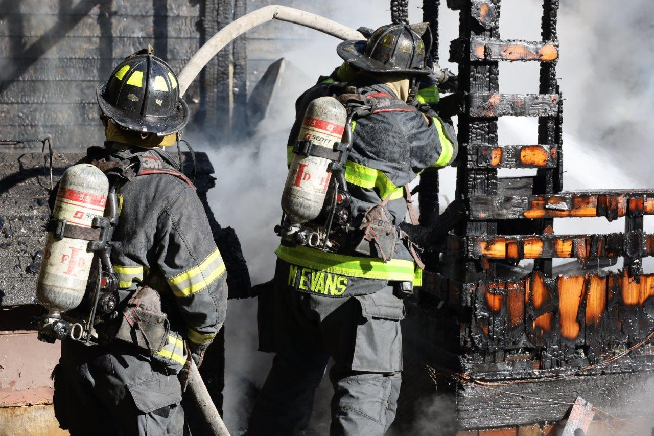 Indianapolis firefighters work to put out a house fire